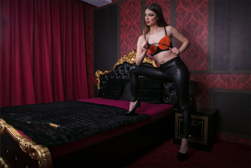 sexy dominatrix in leather pants